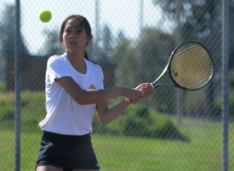 OUTLOOK PHOTO: DAVID BALL - David Douglas' Brittney Cao prepares to hit a backhand return during a second-round doubles win Tuesday morning.