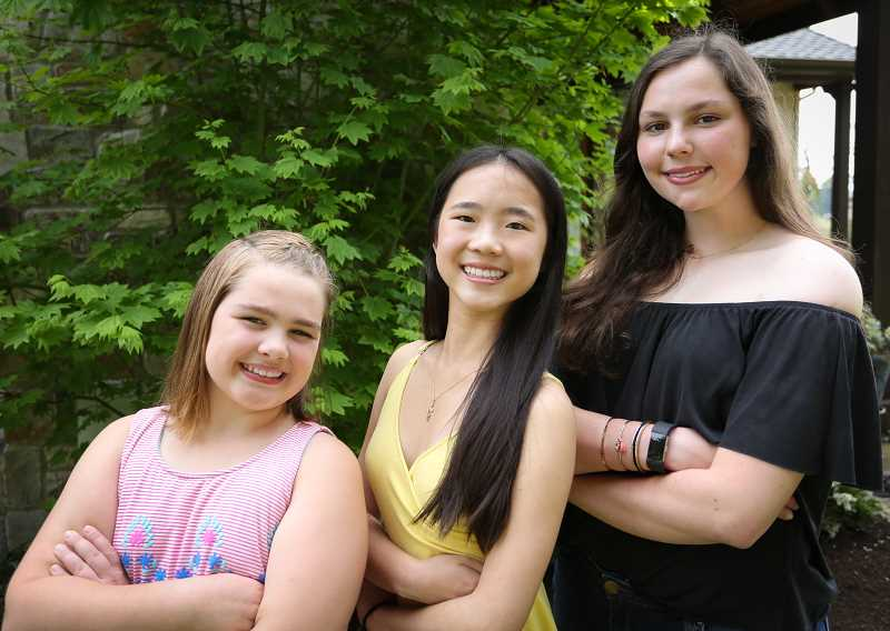 SUBMITTED PHOTO - Local teens Brooklyn Baltz, Summer Tan and Caroline Brandeberry will be honored for their spirit of philanthropy at the West Linn Chamber of Commerce's Mother's Day Dinner and Fashion Show May 11.