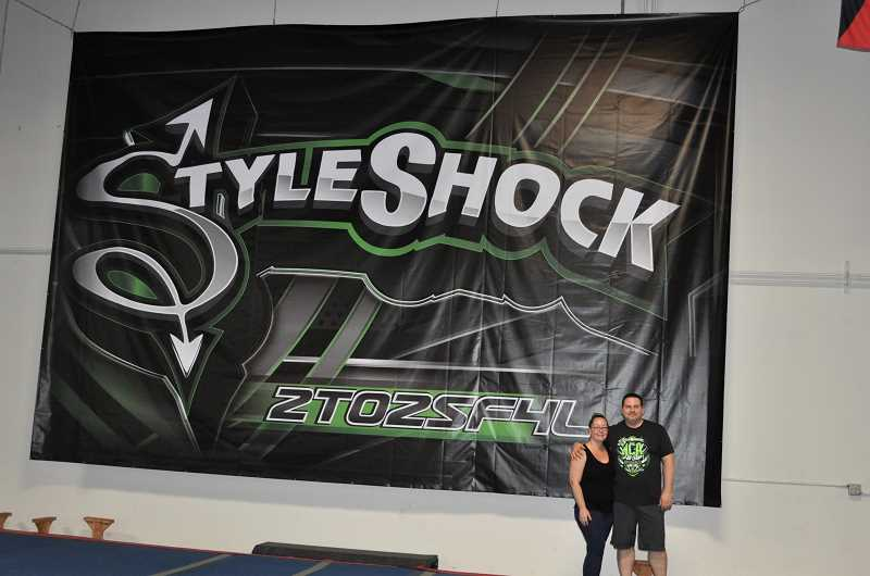 GAZETTE PHOTO: BLAIR STENVICK - Doug Scott poses with his wife Theresa at StyleShock, which he recently relocated to Sherwood.