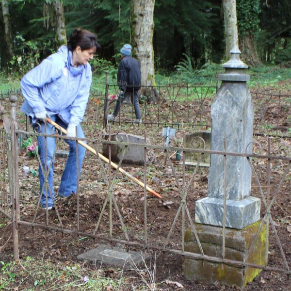 COURTESY OF SOLVE - Volunteers spruce up a cemetery. On Saturday, May 12, others will fan our to historic cemeteries across the state to clean up historic cemeteries, in advance of Memorial Day on May 28.