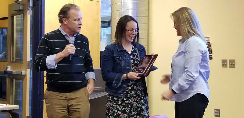 COURTESY PHOTO - Carus kindergarten teacher Nicole Nelson (center) received the April CARE Award.