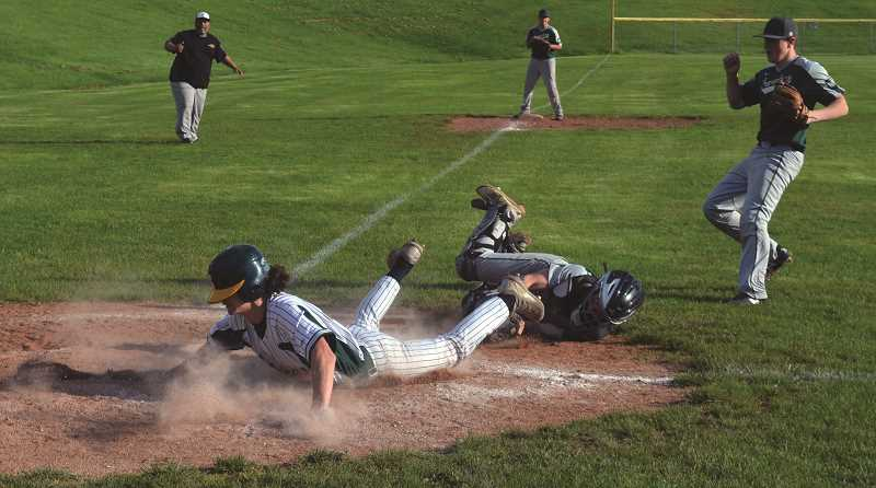 PIONEER PHOTO: TANNER RUSS - Colton's baseball team scored four runs off of passed balls in their 9-7 upset of Salem Academy on Tuesday, May 8.