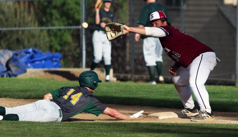 TIMES PHOTO: DAN BROOD - Sherwood senior first baseman Nic Garrison (right) reaches for the ball as West Linn senior Drew Vannaman dives back to the base.