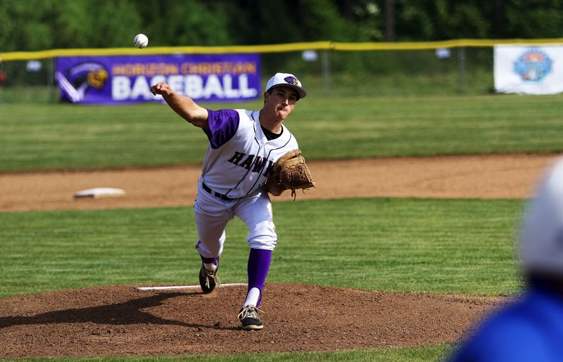 TIMES PHOTO: DAN BROOD - Horizon Christian senior pitcher Nathan Brucker fires in a pitch during the first inning of his no-hitter against Amity.