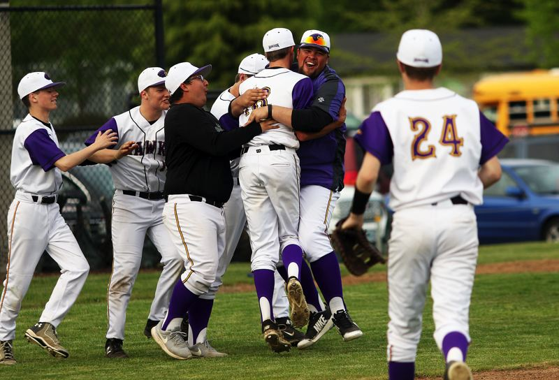 TIMES PHOTO: DAN BROOD - Horizon Christian senior Nathan Brucker is greeted by his teammates and coaches following his no-hit pitching performance against Amity.