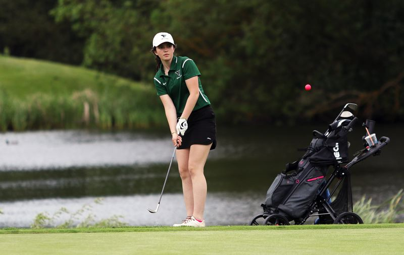 TIMES PHOTO: DAN BROOD - Tigard sophomore Kate Cameron chips onto the green during play Tuesday at the Special District 2 regional tournament.