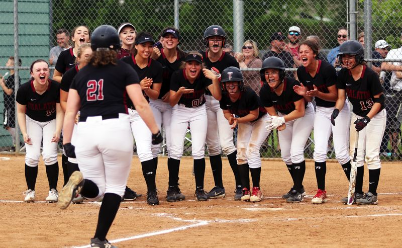 TIMES PHOTO: DAN BROOD - The Tualatin High School softball team waits to greet Timberwolf junior Emily Johansen following the first of her two home runs in the 6-4 win over Tigard.
