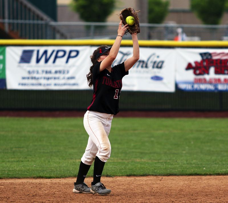 TIMES PHOTO: DAN BROOD - Tualatin junior second baseman Andrea Gomez catches a pop up during Friday's game at Tigard.