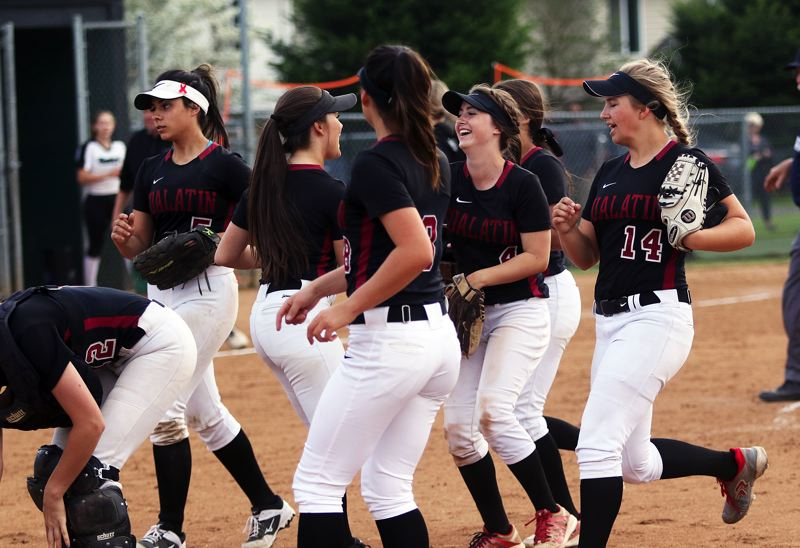 TIMES PHOTO: DAN BROOD - The Timberwolves smile as they run off the field following the 6-4 victory at Tigard.