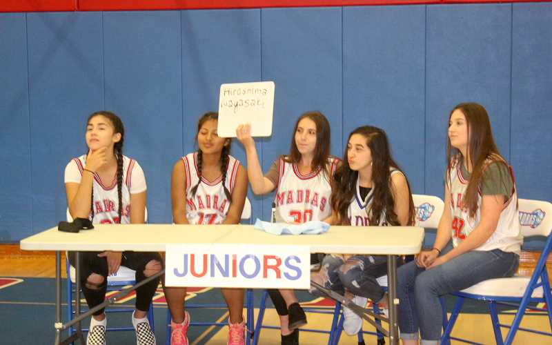 SUSAN MATHENY/MADRAS PIONEER - Juniors, from left, Erika Olivera, Katherinne Parodi, Erica Desjardins, Shania Garcia and Jensen Comment show their answer to a question during the Brain Bowl competition.