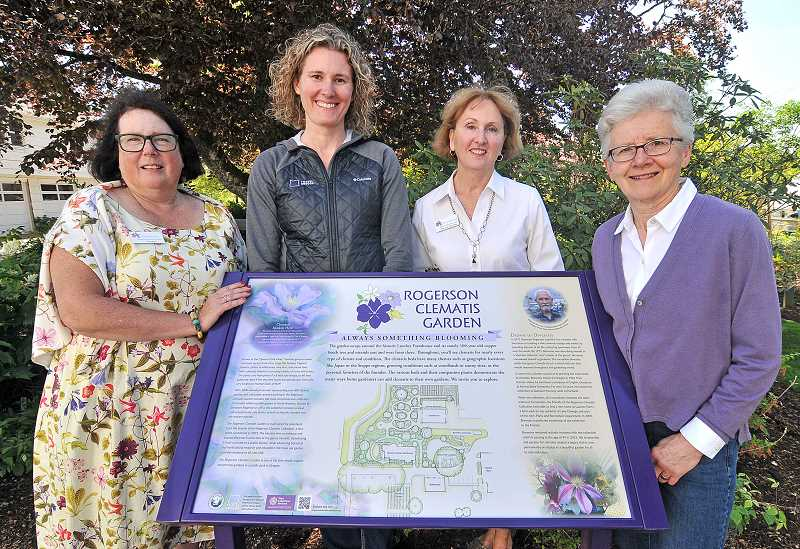 STAFF PHOTO: VERN UYETAKE  - The Rogerson Clematis Collection has received full accreditation and recognition as an official Plant Collection Holder by the American Public Gardens Association. Pictured from left are Linda Beutler, Rogerson Clematis Collection curator, Michelle Woodard, Travel Oregon, Phyllis McCanna , president of Friends of Rogerson Clematis Collection and Nancy Gronowski, past president of the club.