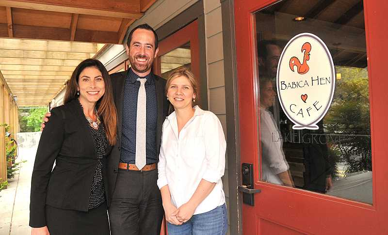 REVIEW PHOTO: VERN UYETAKE - LLS Man of the Year candidate and Lymphoma survivor Kevin Kirkpatrick stands with Vickie Maletteri (left), a coworker at MassMutual, and Babica Hen Cafe general manager Cora Miclea. The Cafe was one of several Lake Oswego businesses that helped fundraise for Kirkpatricks campaign.
