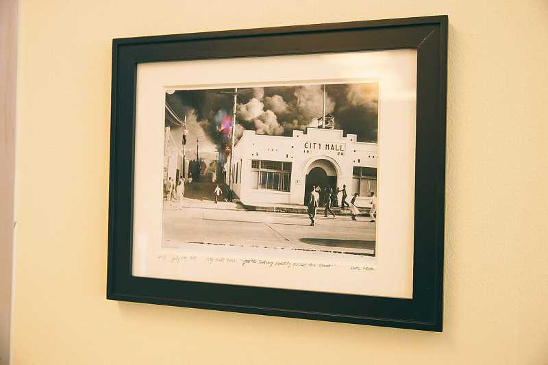 COURTESY PHOTO: BRIAN BROSE - A photo depicting the 1949 fire that destroyed old city hall sits on a wall in the Oswego Creamery facing the exact location of the fire on what is now Lake View Village.