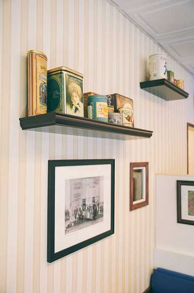 COURTESY PHOTO: BRIAN BROSE - Vintage memerobilia lines accompany many of the historical photos found at the Oswego Creamery as part of the new partnership with the Oswego Heritage House.