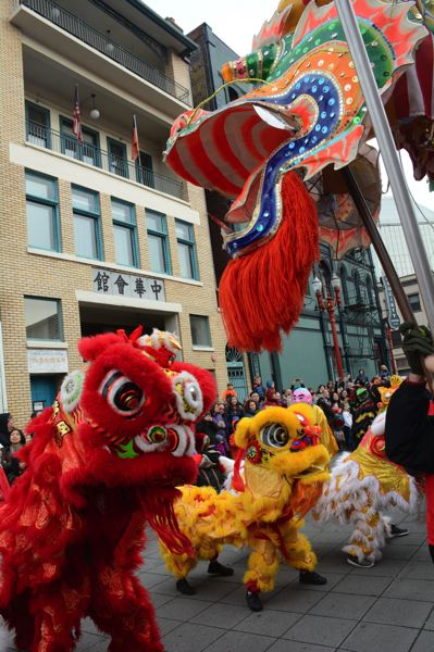COURTESY: PORTLAND CHINATOWN MUSEUM - The 2018 Portland dragon dance celebration and other photos at the new Portland Chinatown Museum tell stories of Oregon's Chinese community then and now.