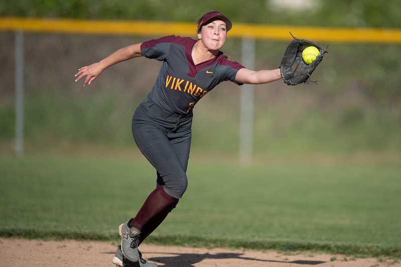 STAFF PHOTO: CHRISTOPHER OERTELL - Forest Grove's Kinsey Barnett snares a line drive during the Vikings' game against Liberty Tuesday, May 8, at Liberty High School.