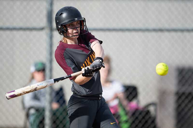 STAFF PHOTO: CHRISTOPHER OERTELL - Forest Grove's Ellie Kintz takes a swing during the Vikings' game against Liberty Tuesday, May 8, at Liberty High School.