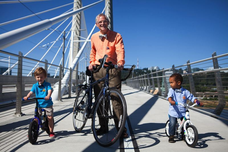 PAMPLIN MEDIA GROUP FILE PHOTO - U.S. Rep. Earl Blumenauer, biking with his grandsons across the Tillikum Crossing when the bridge opened, is highlighting his close ties to Portland and the 3rd Congressional District he has represented since 1996.