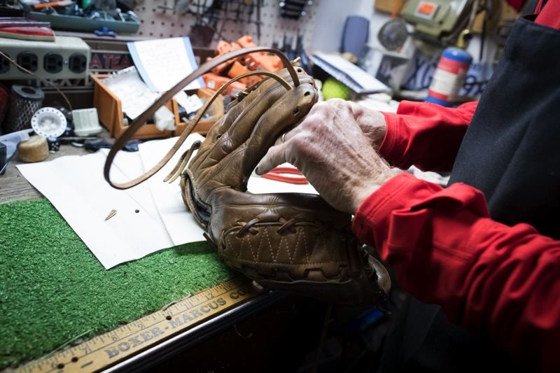 TIMES PHOTO: JAIMES VALDEZ - For Tigard's Tom McGuire, repairing an old baseball or softball glove is a hands-on labor of love.