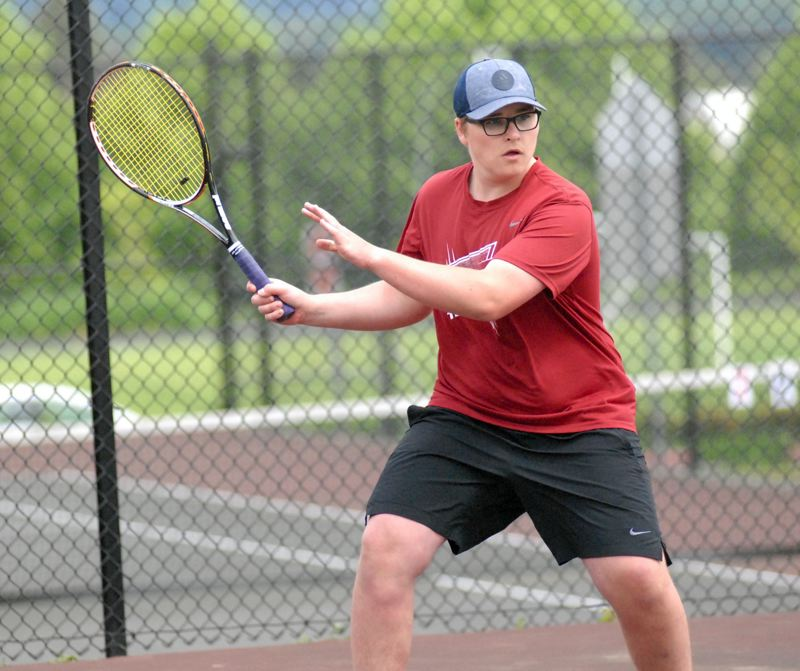 SANDY POST: MATT RAWLINGS - Sandy's Til Wallbruch gets in position to hit a forehand back over the net at the NWOC District tennis meet on Wednesday.