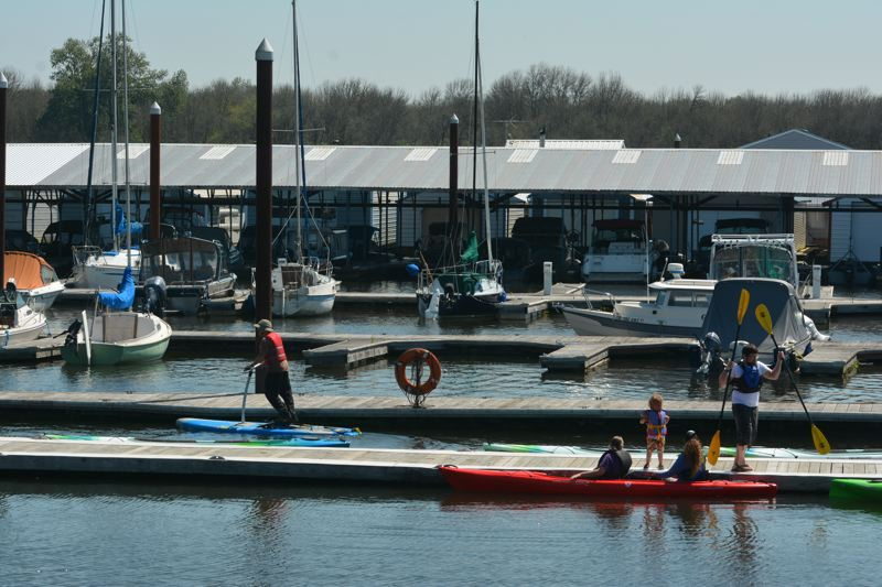 SPOTLIGHT PHOTO: COURTNEY VAUGHN - Paddlers and kayakers take to Scappoose Bay to enjoy sunshine and springtime activities on the water. Scappoose Bay Paddling Center, owned and operated by Portlands Next Adventure, notes most of its customers come from outside Columbia County.