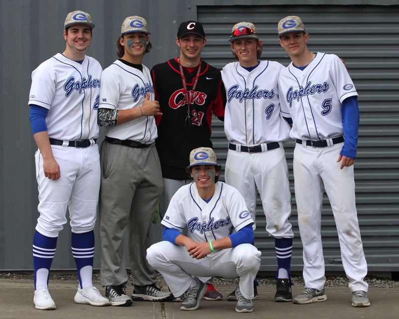 CONTRIBUTED PHOTO: DEBORAH MEHLHAFF - Members of the Gresham Nationals Little League World Series team (from left) Hunter Hemenway, Ethan Meckel, Greg Mehlhaff, Ethan Rose, Christian Turner and (down front) Ezra Samperi pose together after a game at Clackamas last month.
