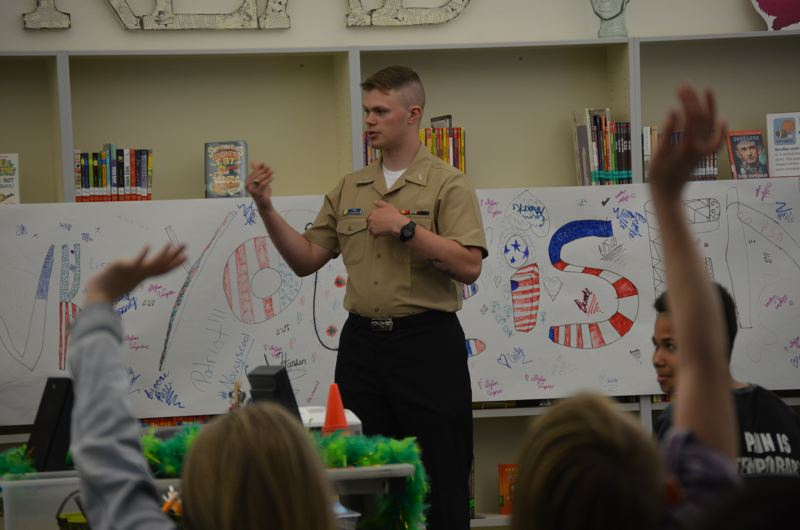 SPOTLIGHT PHOTO: NICOLE THILL-PACHECO - Eisen White, an airman apprentice in the U.S. Navy, visits with students in Jennifer Rangers sixth-grade class at Columbia City Elementary School on Friday, May 4. The students wrote letters to Eisen while he was deployed in Japan last winter.