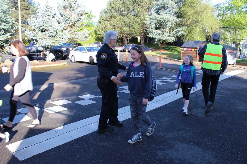 COURTESY OF CITY OF TIGARD: RUDY OWENS - Tigard Police Chief Kathy McAlpine attended Durham Elementary School activities, walking with a group along Southwest Durham Road.