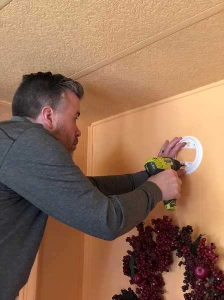 SUBMITTED PHOTO - Red Cross Central and Eastern Oregon Executive Director Shon Keely was among the approximately 50 volulnteers installing smoke detectors on Saturday, May 5, during the Red Cross' Sound the Alarm initiative. Over the course of about seven hours, the Red Cross and Jefferson County Fire Department volunteers installed about 300 smoke detectors in Madras, at no cost to local residents.