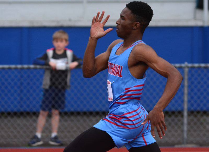 OUTLOOK PHOTO: DAVID BALL - Centennials Jimmie Barton zips toward the finish line in the 200-meter final. He won the 100 earlier in the day.