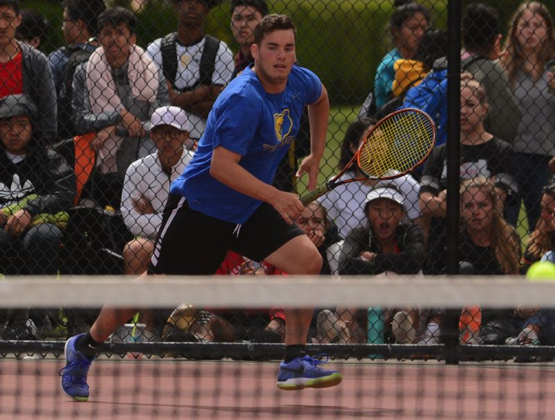 OUTLOOK PHOTO: DAVID BALL - Barlow junior Christian Maxey moves along the baseline to reach a return during his 6-1, 6-1 win over Oregon City's Michael Perez in the district singles final.