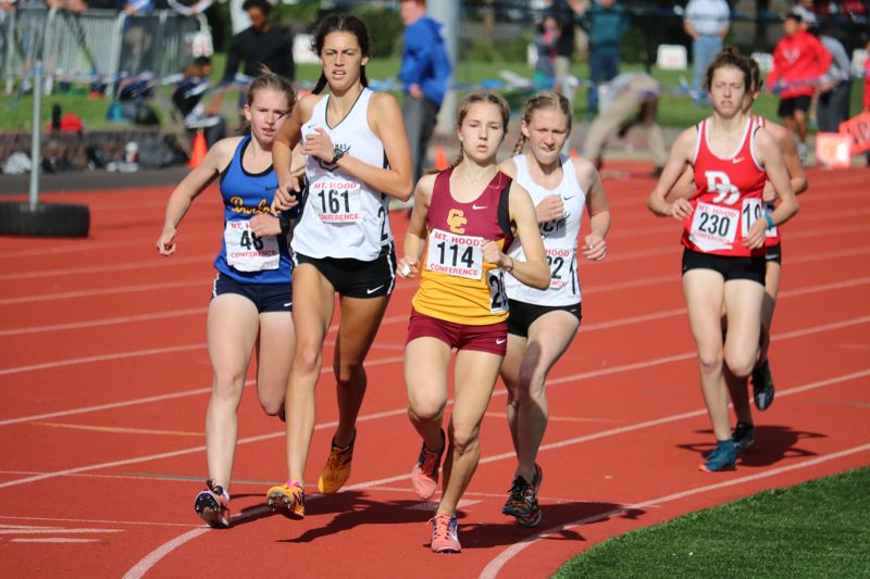 PAMPLIN MEDIA PHOTO: JIM BESEDA - Barlow's Jenessa Teachout (48), Clackamas' Alexa Hayes (161), Central Catholic's Hayley Harrison (114) and Clackamas' Natalie Pihulak (182) set the pace in the girls' 1,500-meter run at Wednesday's Mt. Hood Conference track and field championships at Gresham High School.