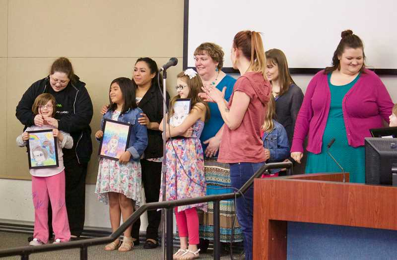OUTLOOK PHOTOS: CHRISTOPHER KEIZUR - Some of the first-place winners were honored during a Gresham City Council meeting alongside their mothers.