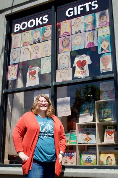 OUTLOOK PHOTOS: CHRISTOPHER KEIZUR - Shoshonna Roberts, owner of Maggie Maes Kids Bookshop in downtown Gresham, is the latest business to display drawings in honor of local moms. 6: This year 2,800 students from the Gresham-Barlow School District drew portraits of their moms for Mothers Day.