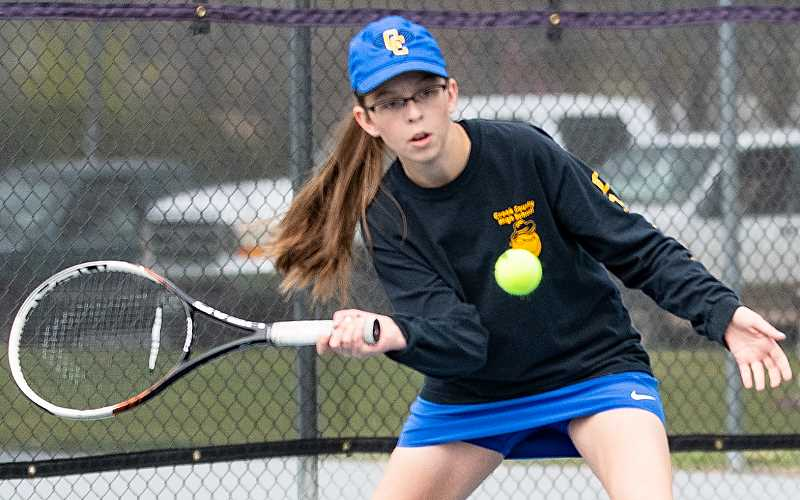 CENTRAL OREGONIAN FILE PHOTO - Olivia Cooper gets ready to play a shot at a home match earlier this year. Cooper lost a heartbreaking three-set match Monday at the Special District tournament, just missing a trip to state.
