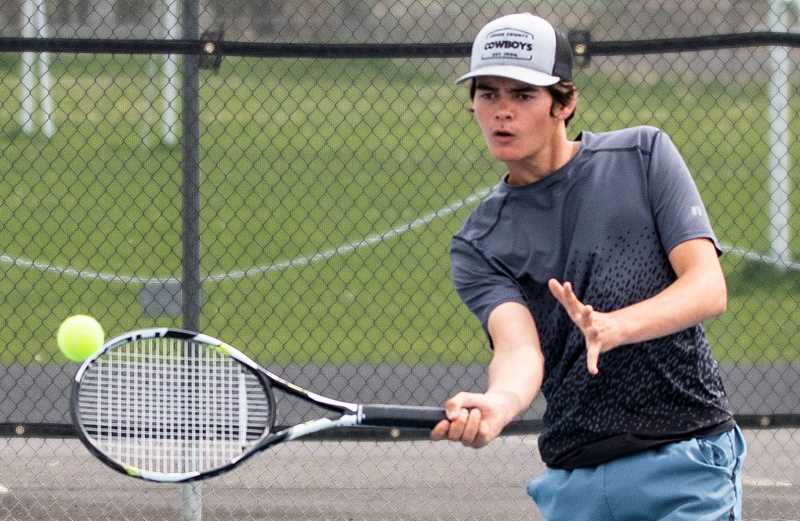 LON AUSTIN/CENTRAL OREGONIAN - Javier Domingez returns a shot during a recent practice. Domingez has qualified for the state tennis championships after upsetting the No. 2 seed during the Special District 2 Tennis Championships.