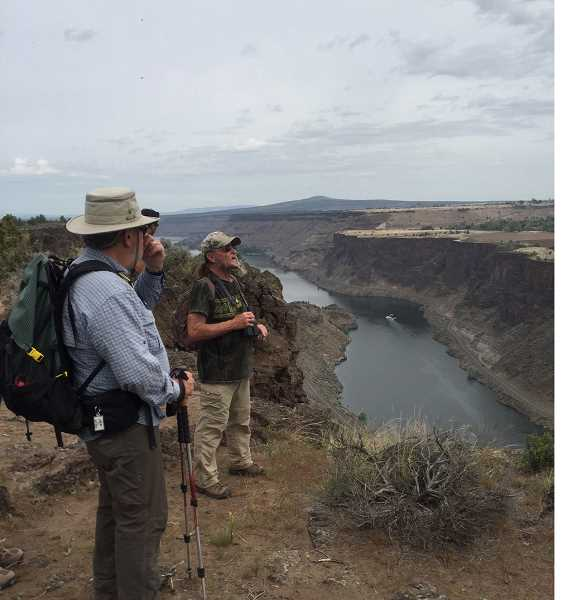 SUSAN MATHENY/MADRAS PIONEER - Dan Chamness, left, and Gary Clowers take in the view of the Lake Billy Chinook canyon.