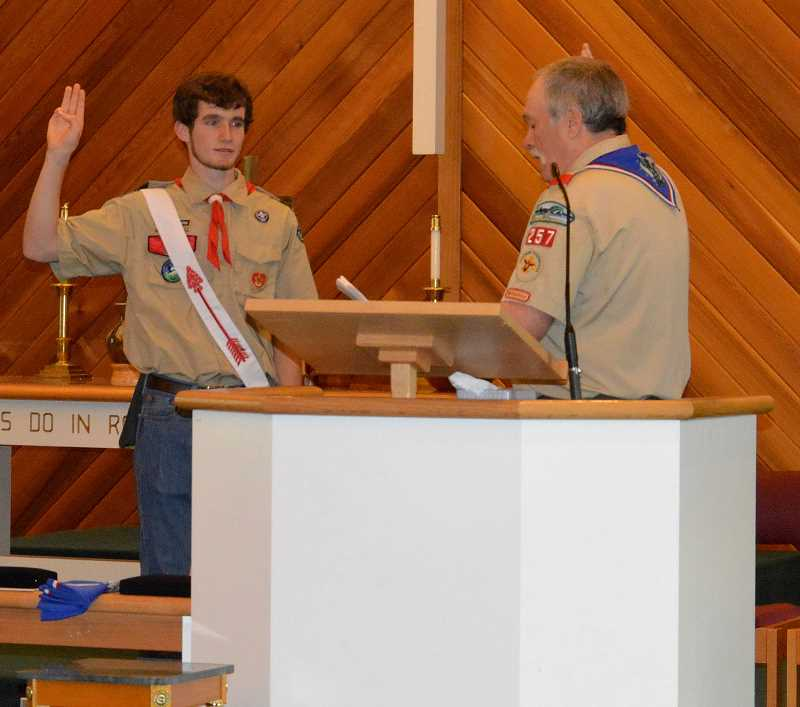 PIONEER PHOTO: CINDY FAMA - Colton High School junior Reed Schrosk receives his Eagle Scout rank from troop #257 Assistant Scoutmaster Gerald Tyler.