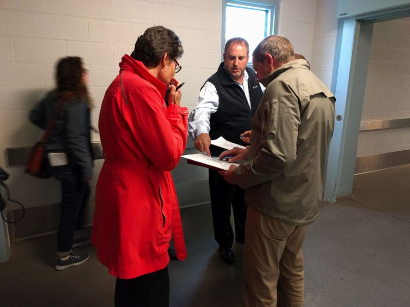PORTLAND TRIBUNE: JIM REDDEN - An employee of Harsch Investment Properties explains the layout of the jail the company now owns.