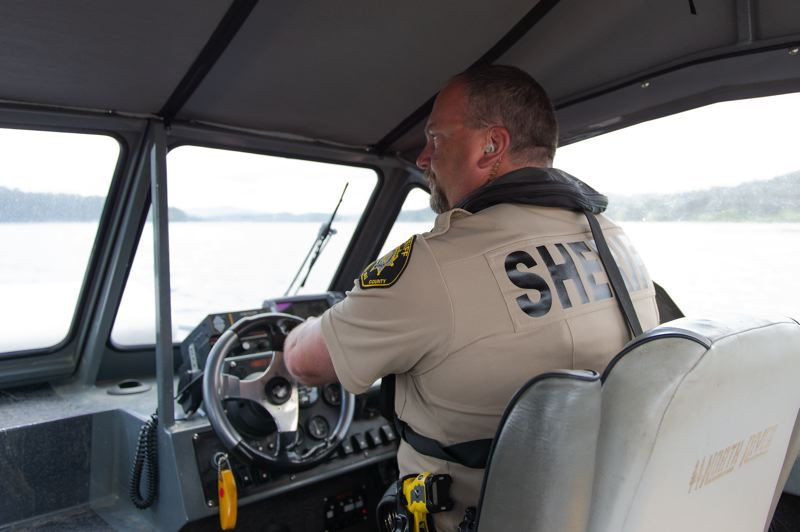STAFF PHOTO: CHRISTOPHER OERTELL - Washington County Sheriff's Deputy Jerry Roley takes a spin on his jetboat during training exercises for new marine patrol officers at Henry Hagg Lake on Wednesday, May 9.