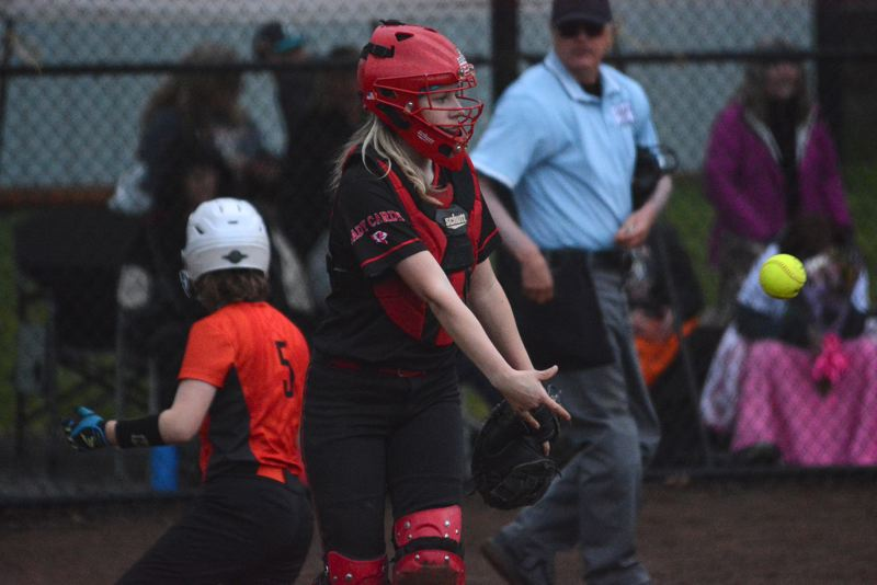 OUTLOOK PHOTO: DAVID BALL - Corbett catcher Lindsey Flegel tosses the ball aside after getting a force out at the plate to turn back a bases-loaded scare in the ninth inning.