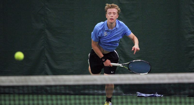 REVIEW PHOTO: MILES VANCE - Lakeridge junior Jack Ninteman hits a serve during his Three Rivers League district singles championship at Portland Tennis Center on Wednesday.