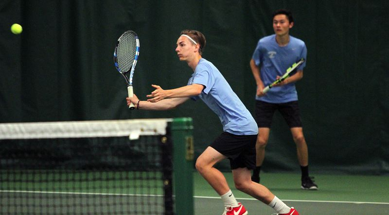 REVIEW PHOTO: MILES VANCE - Lakeridge sophomore Ethan Davies gets ready to make a volley during his win with teammate Dante Sterling in the Three Rivers League district doubles championship at Portland Tennis Center on Wednesday.
