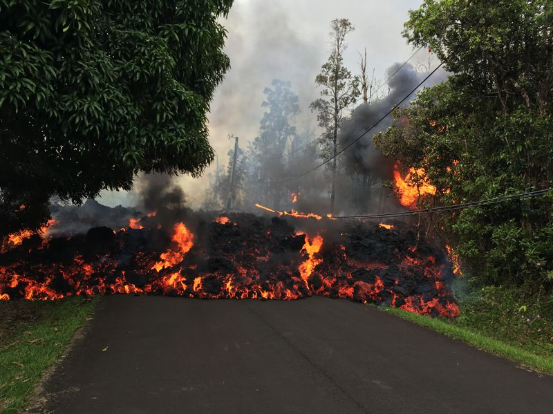 COURTESY PHOTO: USGS - Lava from fissures that opened after a May 3 eruption about a dozen miles from the Kilauea peak has destroyed more than three dozen homes and forced 1,700 residents to flee.