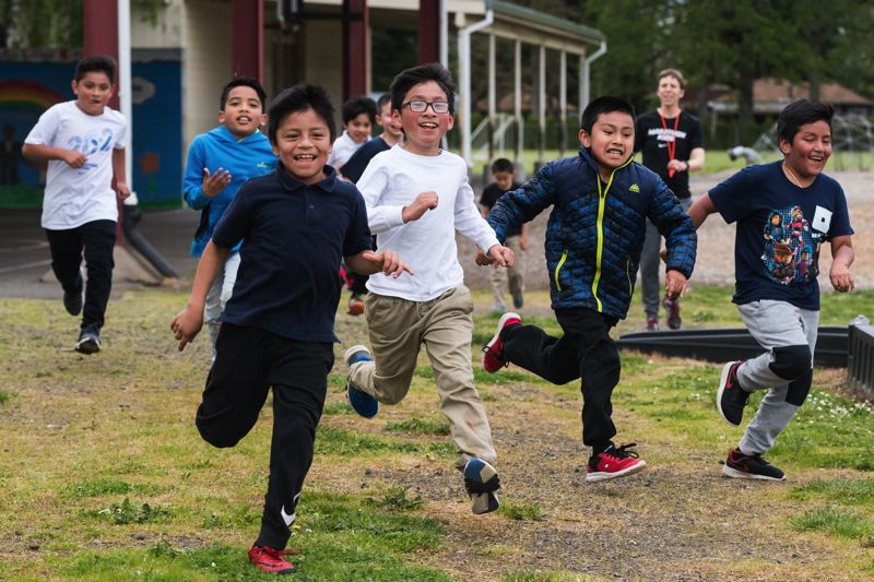 STAFF PHOTO: CHRISTOPHER OERTELL - Third- and fourth-graders run around the school grounds at Cornelius Elementary School on Tuesday, May 1.