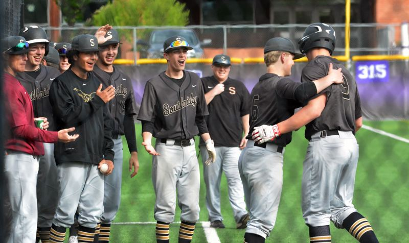 TIMES PHOTO: MATT SINGLEDECKER - The Southridge baseball team celebrates back-to-back homers from Michael Ball and Zach Hald against Sunset.