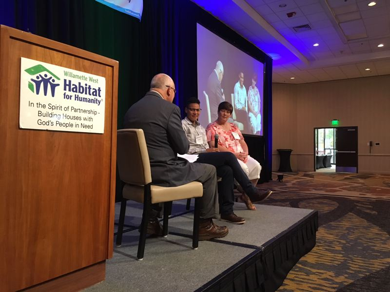 PAMPLIN MEDIA GROUP: PETER WONG - Clive Rainey interviews Adrianna Franch, center, goalkeeper fot the Portland Thorns women's pro soccer team, and her mother Raqual Franch about their experience with a Habitat for Humanity-built house they occupied a decade ago in Salina, Kan. About 300 people attended the fundraiser for the Willamette West affiliate on Friday, May 11, at Embassy Suites in Tigard.