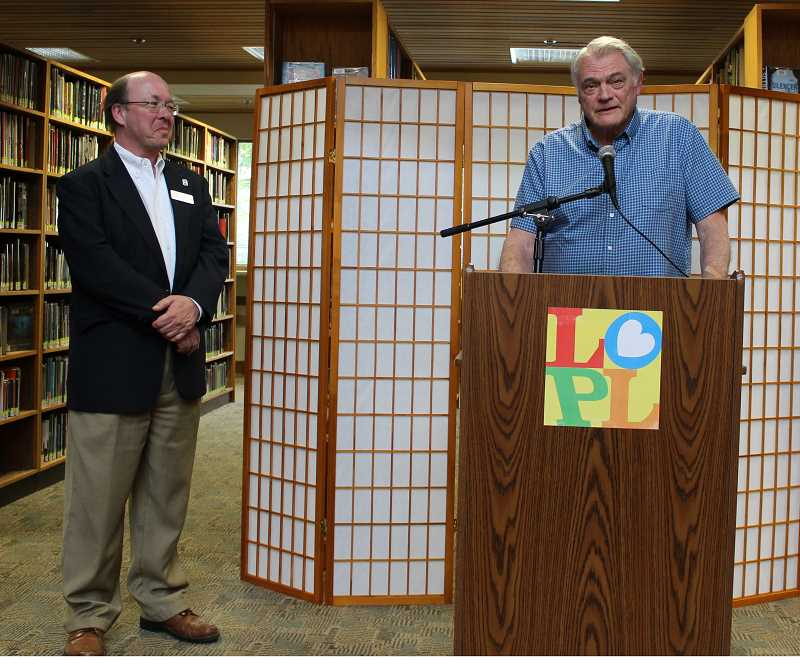 REVIEW PHOTO: ANTHONY MACUK - Lake Oswego Library Director Bill Baars (left) looks on while Old Town Neighborhood Association chair Craig Stephens explains the origins of the poetry contest.