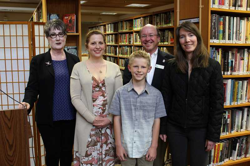 REVIEW PHOTO: ANTHONY MACUK - Poetry contest winners Luke Donaldson, Lisa Helfer and Lisa Brisley stand with Lake Oswego Preservation Society President MaryLou Colver and Library Director Bill Baars. From left: Colver, Helfer, Donaldson in front, Baars and Brisley.