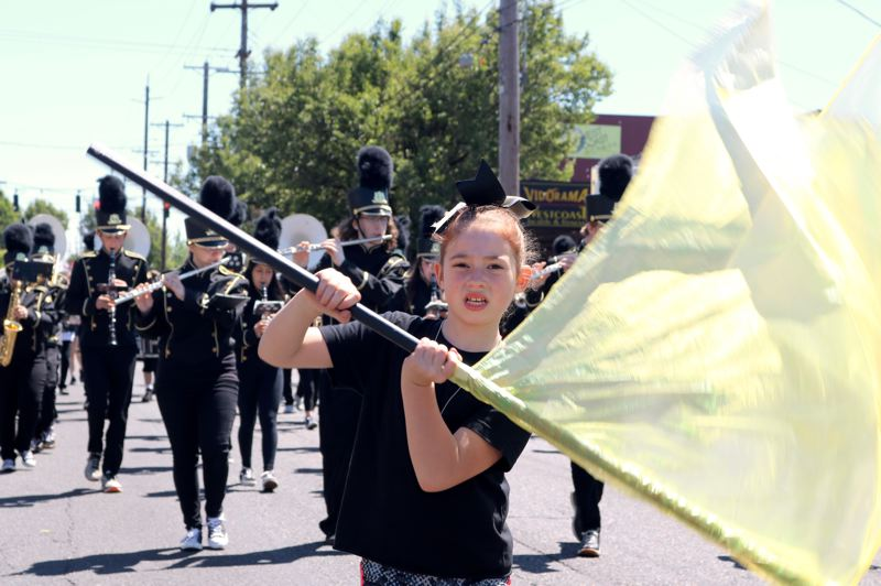 TRIBUNE PHOTO: ZANE SPARLING - Members of the Roosevelt High School marching band tromp along during the 56th Annual St. Johns Parade in Portland.